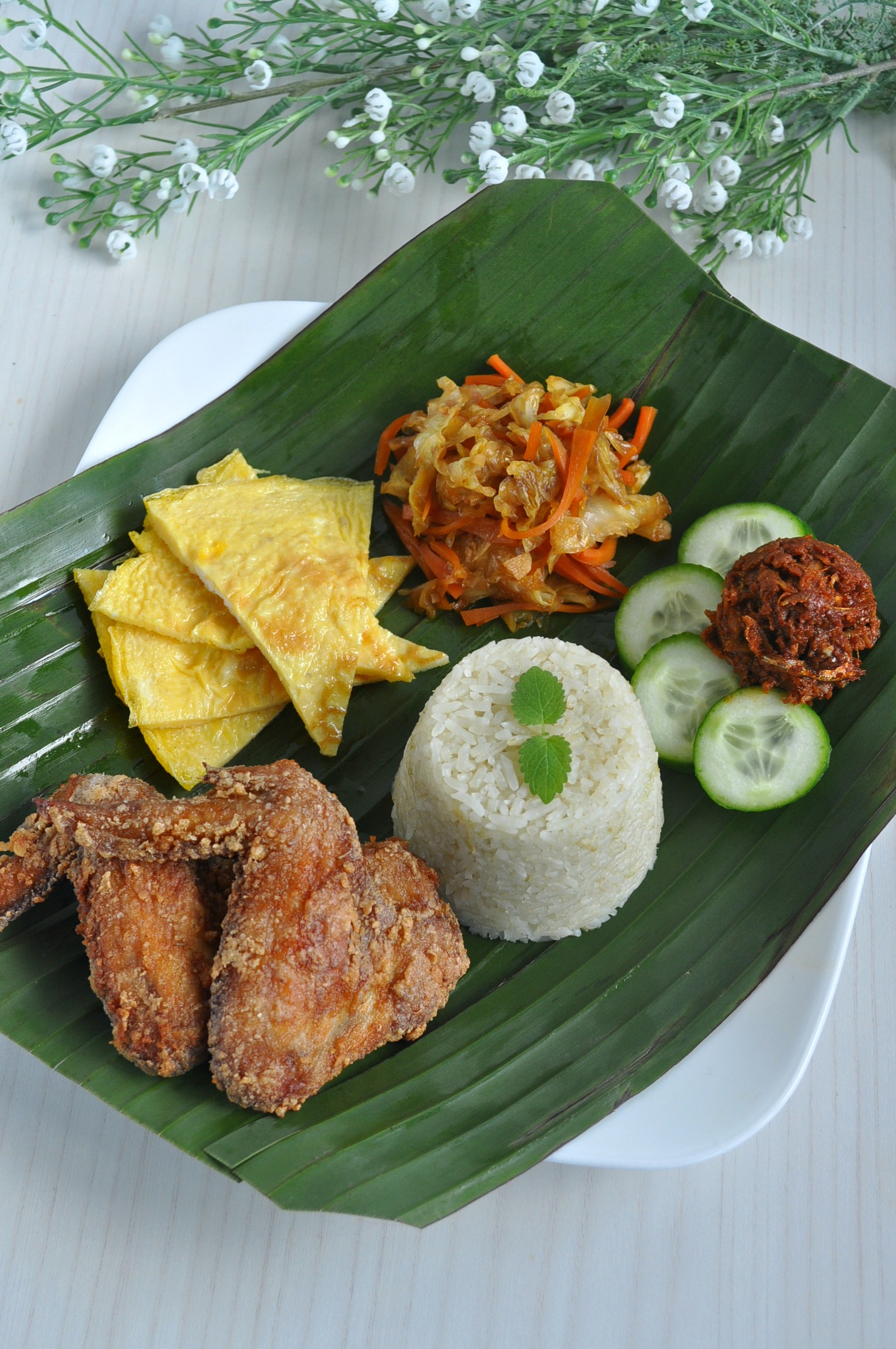 nasi lemak I'm sure nasi lemak needs no introduction but for the uninitiated, this iconic local food is essentially rice cooked in rich coconut milk, and served with fried.